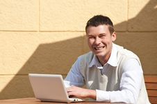 Free Man Using A Laptop Outdoors Royalty Free Stock Images - 19467109