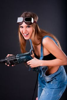 Free Girl With A Drill Royalty Free Stock Image - 19467626