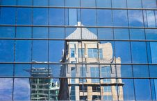 Buildings Reflected In The Mirror Stock Images