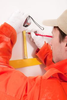 Free Construction Worker Doing Measuring Royalty Free Stock Photos - 19467808