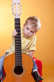 Child Proposing Play The Guitar Stock Photo