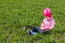 Free Little Girl Sitting With A Noteboot Stock Images - 19469194