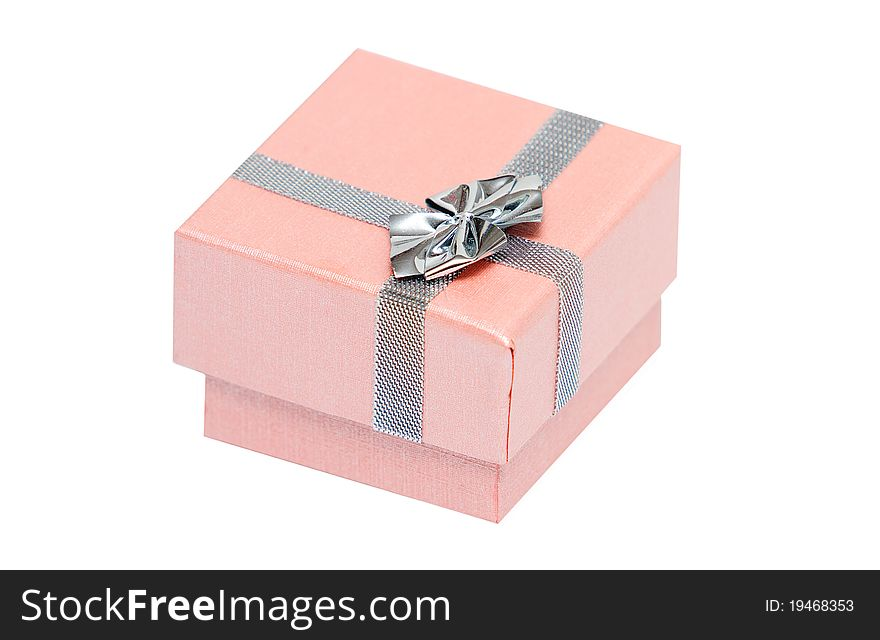 Small pink present box with silver ribbon
