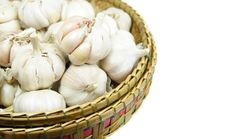 Garlic Bulbs In A Wicker Basket Stock Photos