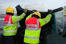 Firemen Removing Brocken Windscreen At Car Crash Stock Image