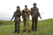 Free Three Soldiers Outdoors Posing Royalty Free Stock Photography - 19473297