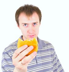 Free The Young Man Eats A Hamburger Stock Images - 19473934