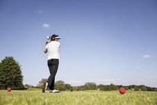 Free Woman Teeing Off. Stock Photography - 19475332