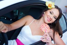 Free Young Woman With Candy With New Car Royalty Free Stock Image - 19475376