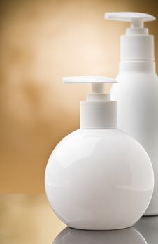 Copyspace View On Two White Round Bottles Royalty Free Stock Photo