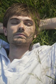 Free Man Sleeping In Field Royalty Free Stock Photography - 19476187
