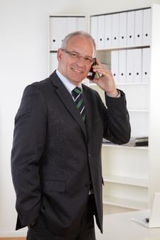 Free Old Business Man At Telephone Stock Photography - 19478392