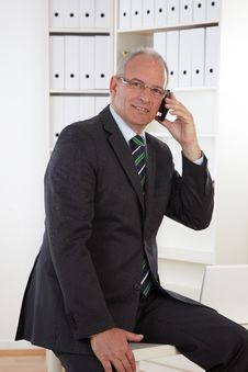 Free Old Business Man At Telephone Stock Photos - 19478443