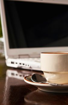 Free A Cup Of Coffee And White Notebook Stock Photography - 19479022