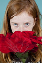 Free Young Girl Is Looking At You Over A Big Rose Stock Photo - 19484080
