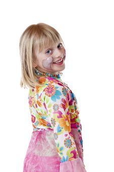 Young Blond Girl In Carnival Costume Smiles Stock Photography