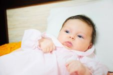 Beautiful Baby Girl Is Lying In A Bed. Stock Photography