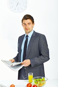 Free Businessman Holding Newspaper Royalty Free Stock Photography - 19488437