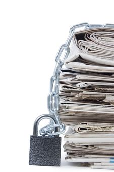 Free Pile Of Newspapers With Chains Stock Photo - 19489520