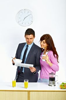 Couple Reading News And Eat Royalty Free Stock Photos