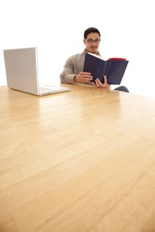 Free Man Big Table Reading Stock Photography - 19491102