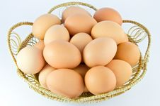 Free Chicken Eggs In A Basket On White Background Royalty Free Stock Images - 19494379