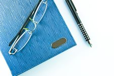 Free Glasses On Blue Notebook  With Black Pen Royalty Free Stock Photography - 19494477