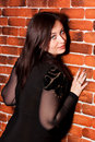 Free Beautiful Woman Leaning Against Brick Wall Royalty Free Stock Photography - 19509827