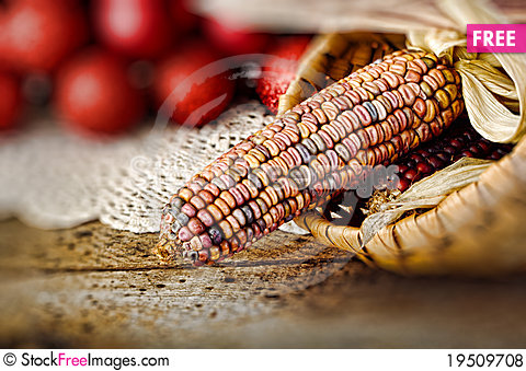 Ear of Indian corn in basket Stock Photo