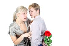 Couple With Gift And Flower Royalty Free Stock Photo