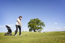 Woman Focusing On Golf Fairway. Stock Image