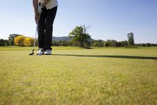 Female Golf Player Putting Ball. Royalty Free Stock Photos