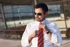 Business Person Adjusting Tie. Stock Images
