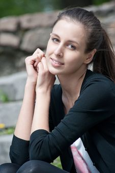 Free Portrait Of Beutiful Young Woman Sitting Outdoors Royalty Free Stock Photo - 19500725