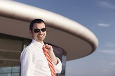 Smiling Businessman In Front Of Office Building. Stock Photography