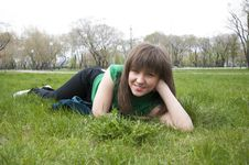 Free Young Girl Lying On The Grass Royalty Free Stock Image - 19502266
