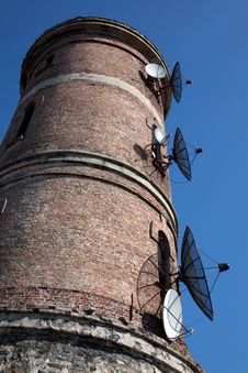 Modern Communications Antenna On An Old Tower Royalty Free Stock Photos