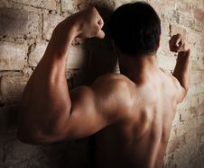 Free Boy Is Showing His  Biceps Royalty Free Stock Photos - 19509348