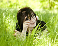 Free Young Teen Girl In Glasses At Green Grass Royalty Free Stock Photography - 19516937