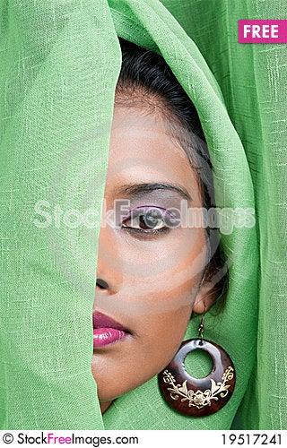 Woman peeking through curtain Stock Photo