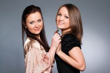 Beautiful Sisters Holding Hands Stock Photos