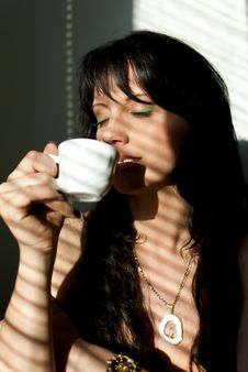 Girl With A Cup Of Coffee Stock Image
