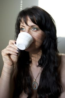Girl With A Cup Of Coffee Stock Photo