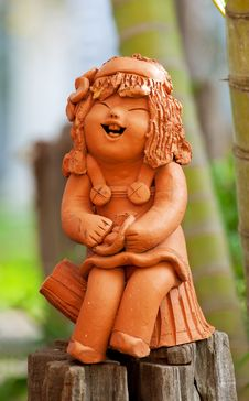 Free Pottery Statuette Of Happy Girl Stock Photo - 19513160