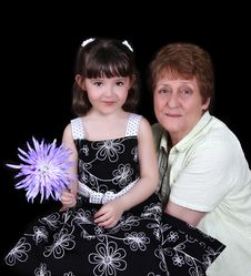 Grandmother And Young Granddaughter Smiling. Stock Photo