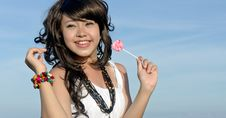 Free Young Pretty Asian Girl Enjoys Eating Candy Royalty Free Stock Image - 19515016