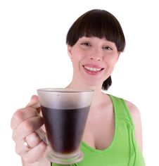 The Young Woman Drinks Coffee Royalty Free Stock Image