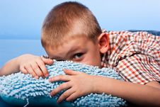 Cute Boy Resting On A Pillow Royalty Free Stock Photos