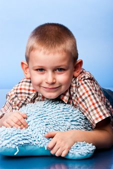 Cute Boy Resting On A Pillow Stock Photography