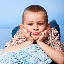 Cute Boy Resting On A Pillow Royalty Free Stock Images
